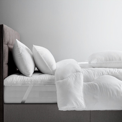 John Lewis & Partners Synthetic Mattress Topper on a bed